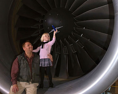 Man and girl with model plane